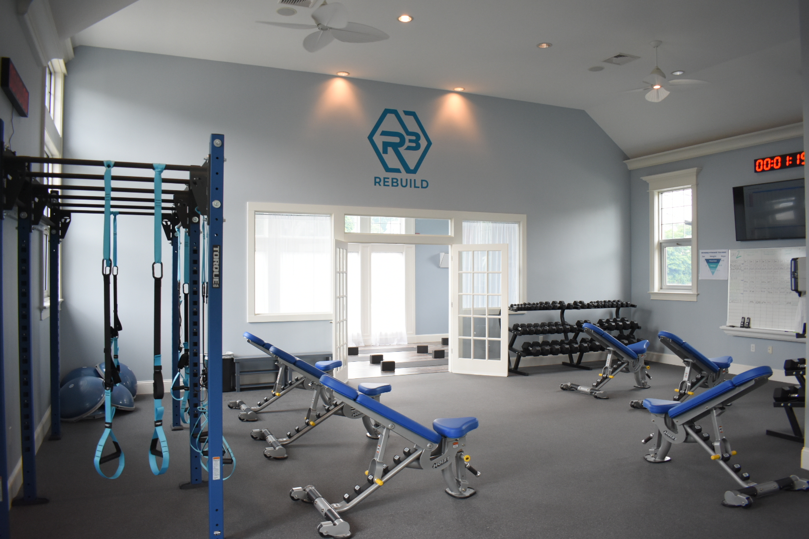 rebuild room with dumbells, benches, TRX, bosu balls